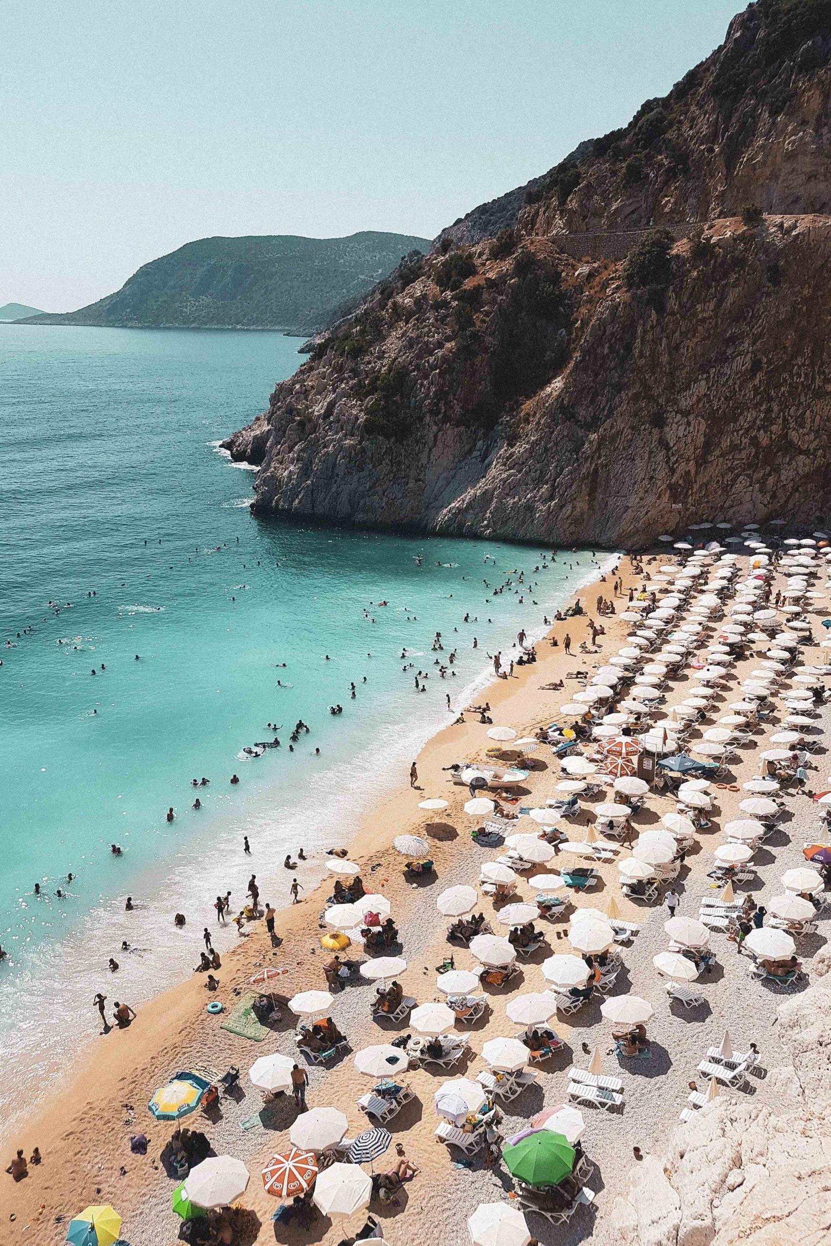 Beach with umbrellas and sunbeds in Antalya, Turkey