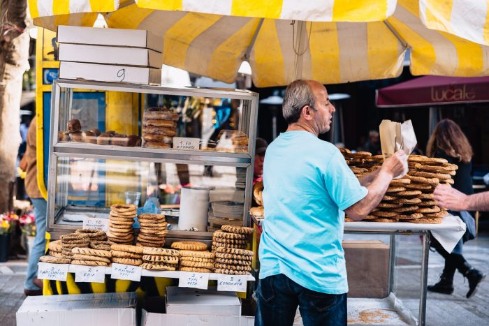 A display of Koulouri sesame bread rings on a street food stall in Athens
